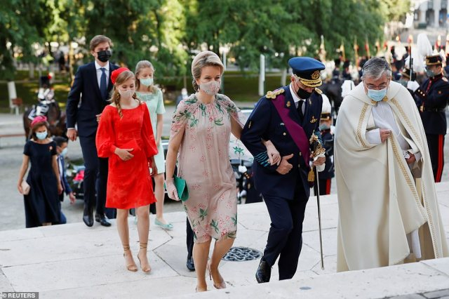 Mother-of-four Mathilde opted for a floaty rose pink dress with pretty floral embroidery and cape detailing. She wore the outfit with an emerald green clutch bag and elegant powder pink heels