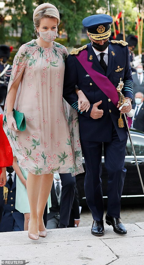 Showcasing her eye for detail, Mathilde wore a mask in the same pattern as her dress and carried a bag in the same green as the floral print