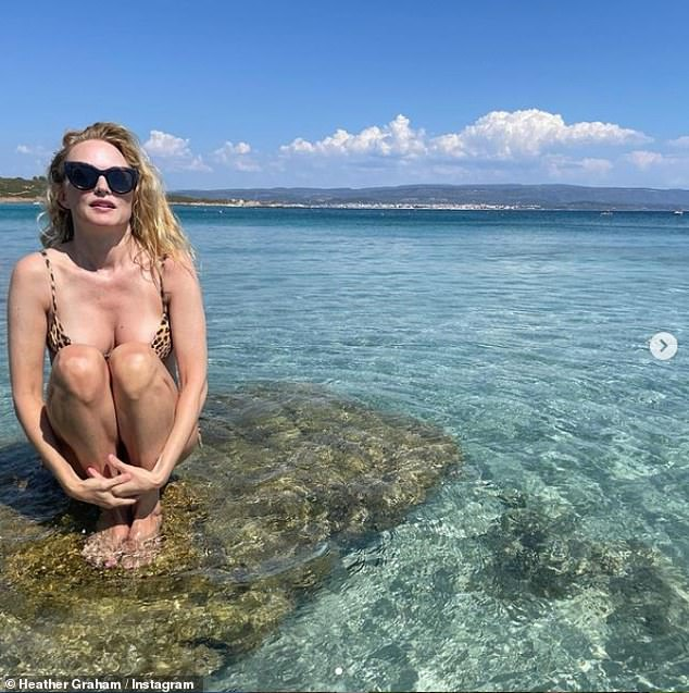Getaway:Heather Graham is quite the jet-setter as she posed in the Italian waters in a leopard-print bikini on Wednesday after leaving Greece (pictured above on Instagram)