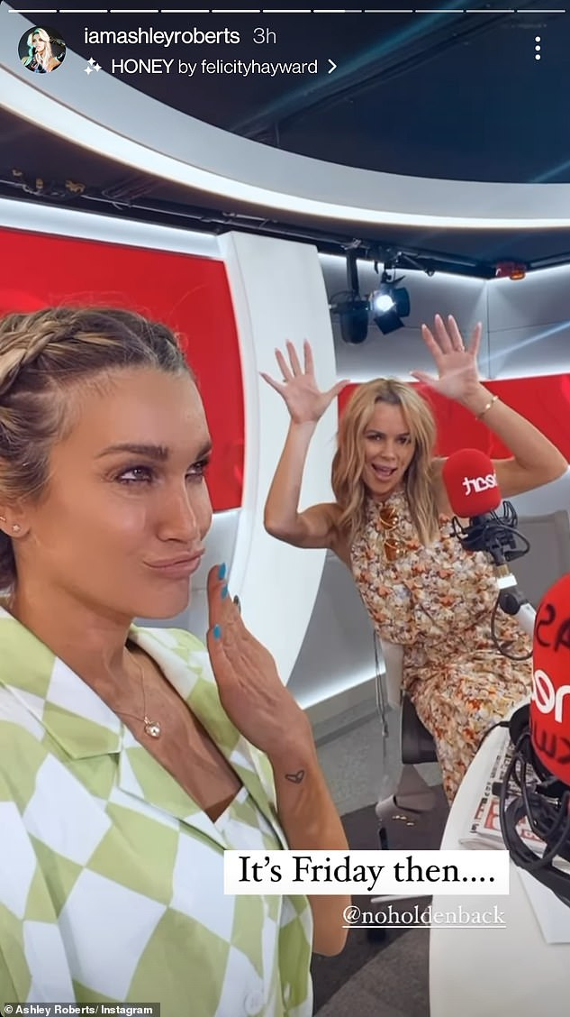 Selfie:The model also shared snaps of her at the Heart studio with Amanda Holden, penning: 'It's Friday then....' and tagging her co-worker @noholdenback