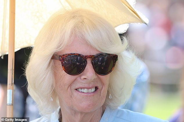 The Duchess of Cornwall teamed her below-the-knee dress with simple silver jewellery and drop earrings