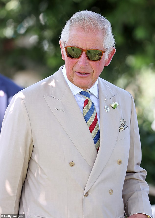 The Prince of Wales cut a cool figure in a pair of tortoiseshell sunglasses which he paired with a beige-coloured suit