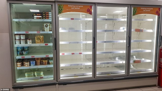An empty freezer section at a Sainsbury's Local in Bristol today amid complaints that a shortage of drivers was making it difficult to deliver food products