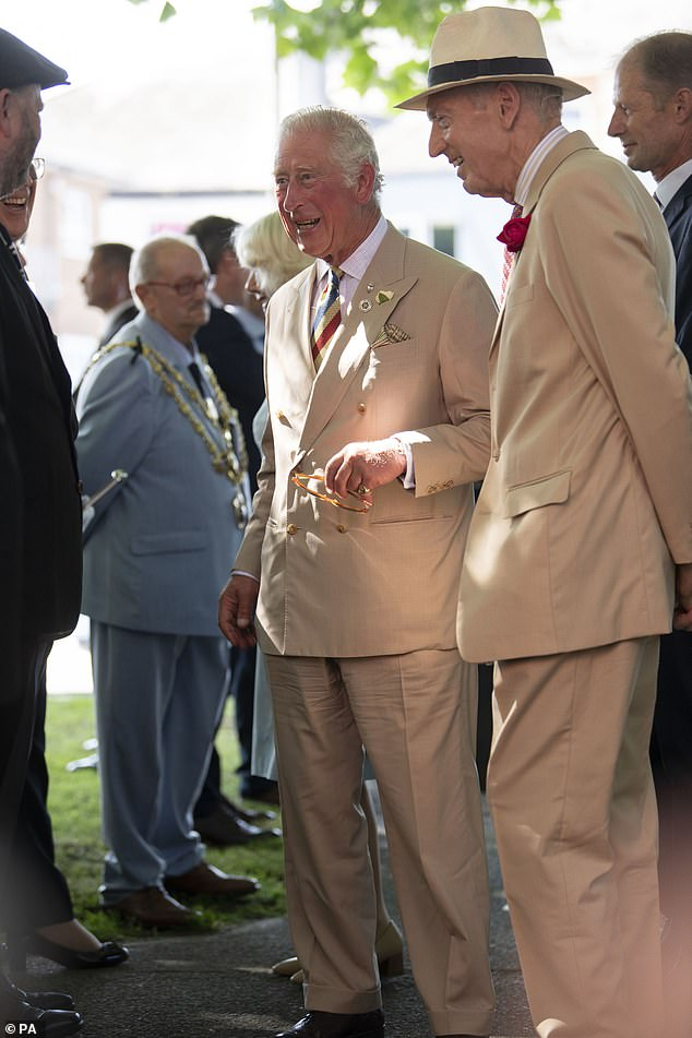 The Prince of Wales (centre) during a visit The Burton at Bideford to celebrate the art gallery's 70th anniversary