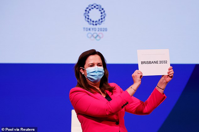 Annastacia Palaszczuk celebrates after Brisbane was announced as the host of the 2032 Summer Olympics (pictured in Tokyo on Wednesday)
