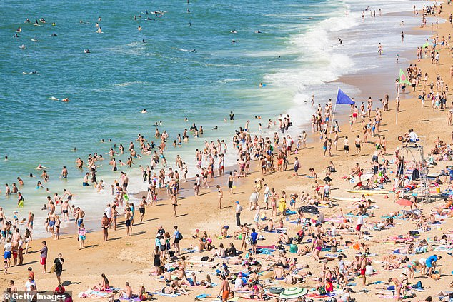 Travellers from France are now required to quarantine even if they are double-jabbed. Pictured: People enjoying the beach in Aquitaine, France