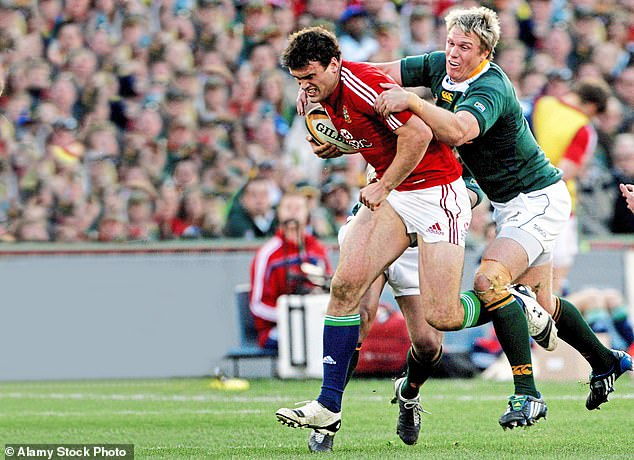 Rugby has 'changed beyond all recognition' since the 1990s, according to the Drake Foundation. Pictured, Jamie Roberts of the British and Irish Lions (left) with South Africa's Jean de Villiers during the second rugby union test match in Pretoria, June 2009