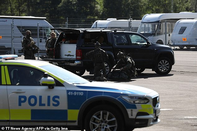 Pictured:Special unit police forces are seen by a car parked outside the Hallby Prison near Eskilstuna, Sweden, on July 21, 2021, where two prison guards have been taken hostage