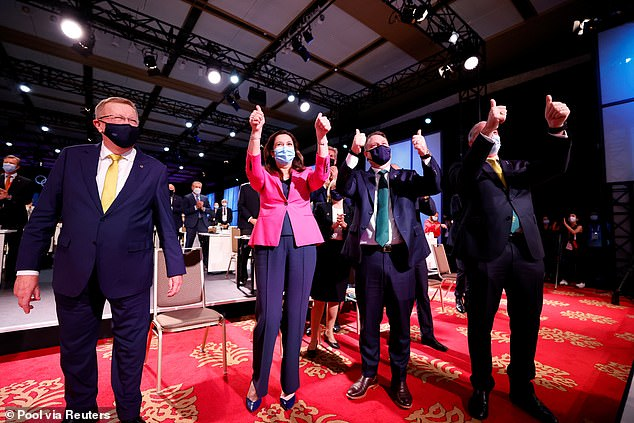 Leaders hope that Games will see Brisbane put on the global map in the same way Sydney was after the Harbour City's world-renowned effort in 2000 (pictured, the Queensland premier celebrates in Tokyo)
