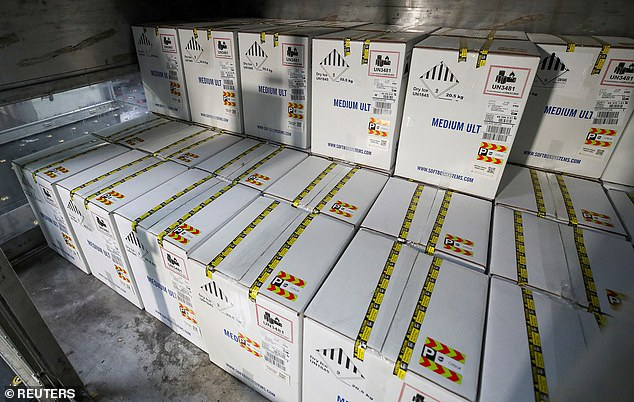 Million of unused COVID-19 vaccines doses are set to expire in the next two months as demand drops off and have asked to send their unused doses overseas. Pictured:Boxes containing Pfizer's COVID-19 vaccine are unloaded from air shipping containers in Louisville, Kentucky, December 2020