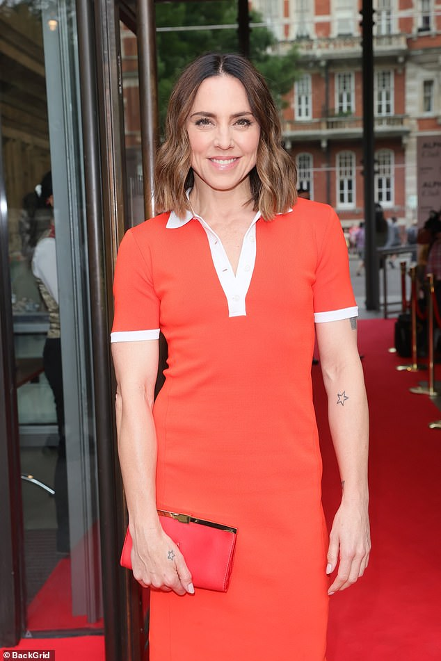 Icon:The Wannabe hitmaker, 47, looked stunning in the bold midi dress, which featured a white polo neck style neckline, cuffed short sleeves and a split at the back
