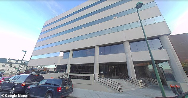Alaska Assistant Attorney General Matthias Cicotte was accused of running a racist social media account under the alter ego J. Rueben Clark. The Department of Law, pictured above, is investigating, it says