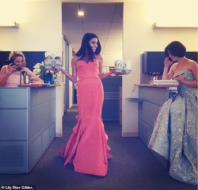 Lily is pictured with her two fellow assistants in ballgowns in the the office in 2015