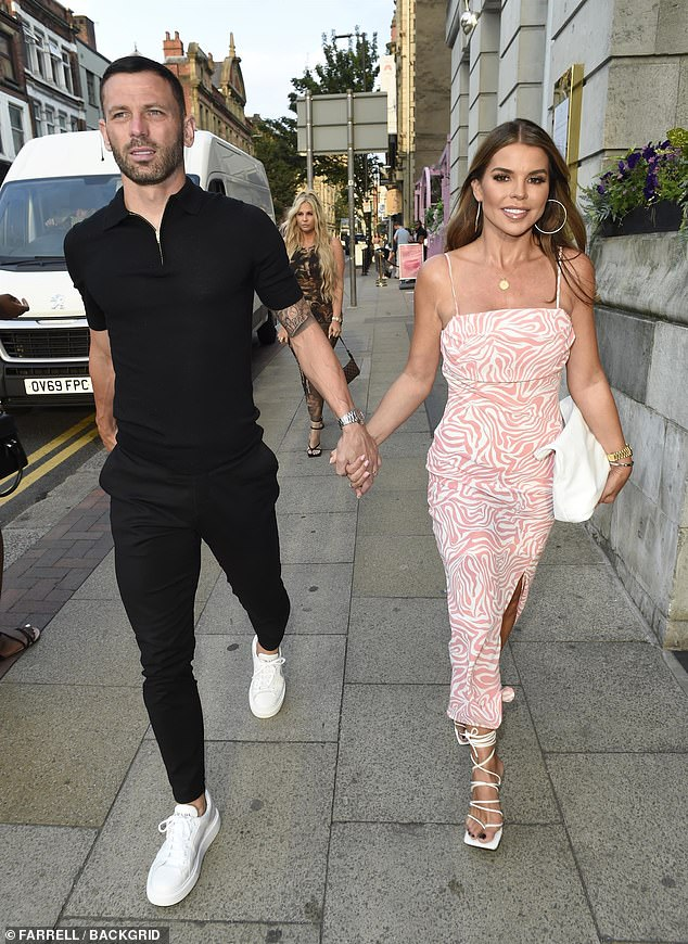 Couple:Tanya, 40, looked incredible in a pastel pink and white printed dress with a racy thigh-split as she arrived at Boujee Restaurant & Bar hand-in-hand with husband Phil