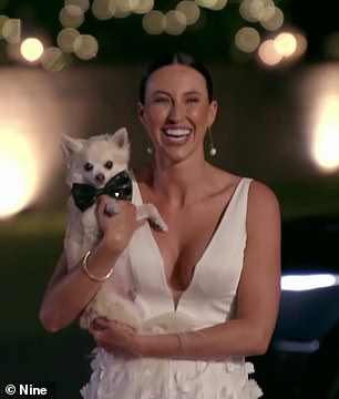 Puppy love: Stevie Grey (pictured) also brought out the big guns for her big entrance, bringing both an adorable chihuahua as well as an unfettered view of her cleavage in a plunging white ballgown