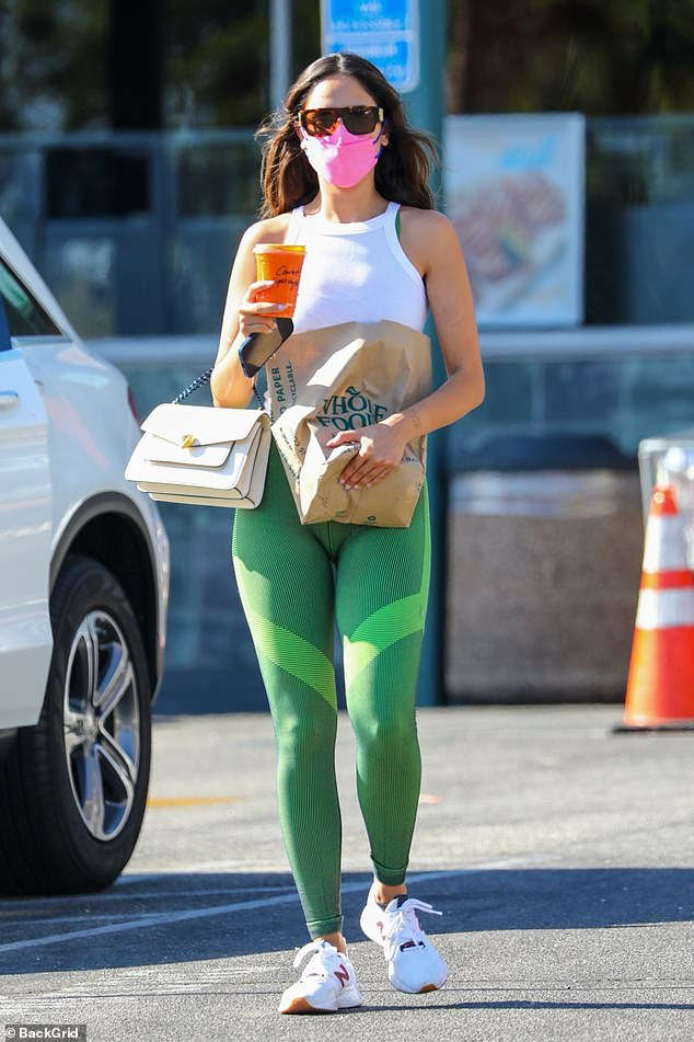 Errand: Eiza Gonzalez showed off her gym-honed physique as she picked up some groceries after a workout session in LA on Wednesday