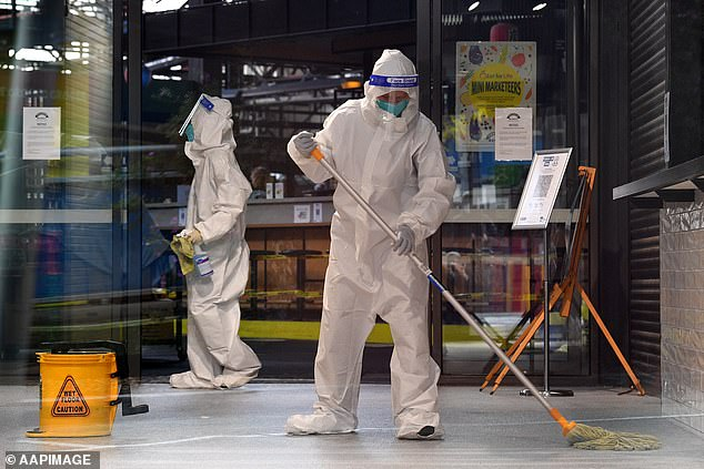 Cleaners at work at Melbourne's Prahran Market on Thursday after a customer tested positive for Covid-19
