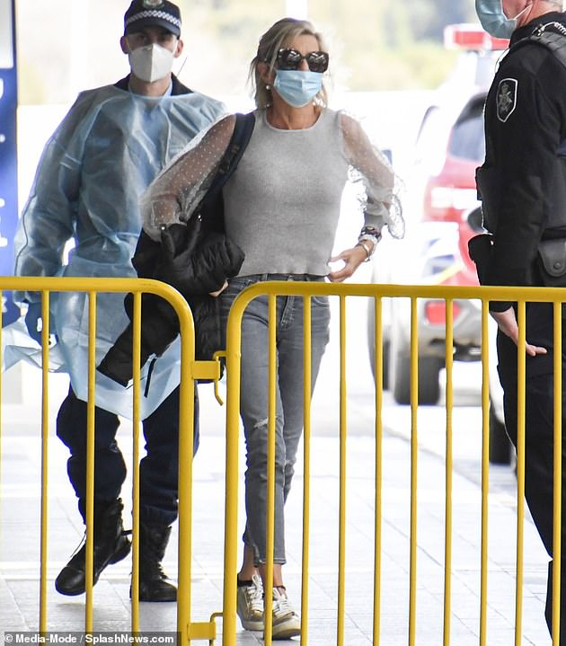 Hopkins wore sunglasses as she walked into the international terminal on Monday afternoon