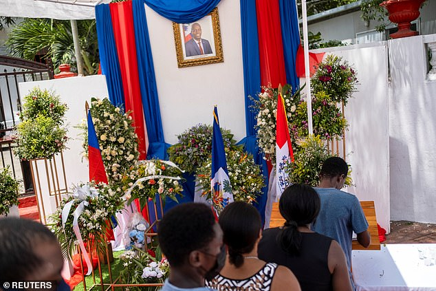People wishing to pay tribute to Jovenel were seen lining up write in a book of condolences in the northern