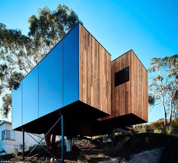 A wooden box on stilts overlooking the ocean on the wild coast of southeastern Tasmania is Australia's 'highest wish list' unique residence for 2021