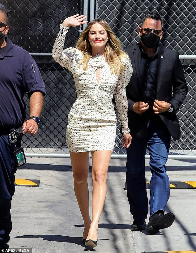 On the spot: The Aussie stunner's minidress showed off her long legs and superior sense of style