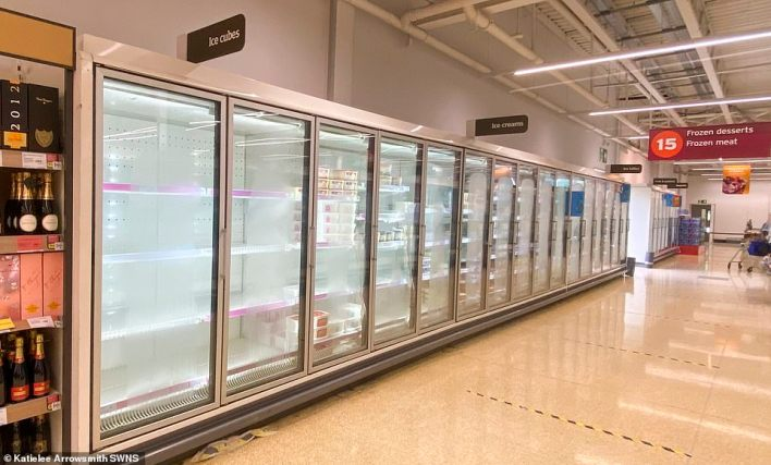 Freezers empty at Sainsbury's in Craigleith, Edinburgh, overnight as the 'pingdemic' decimates Britain's retailers