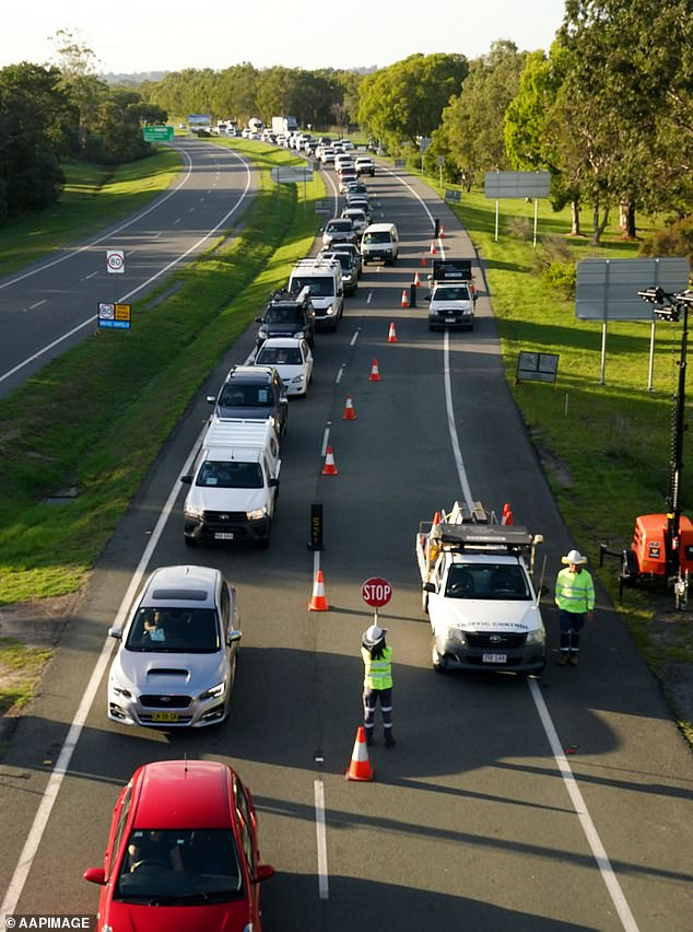A truck driver reportedly assaulted and hit his vehicle after giving two invalid border passes to police at the NSW-QLD border (pictured)