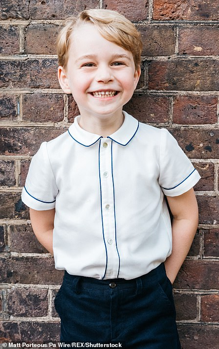 All smiles! Prince George also showed off his gap-toothed grin in his official portrait for his fifth birthday