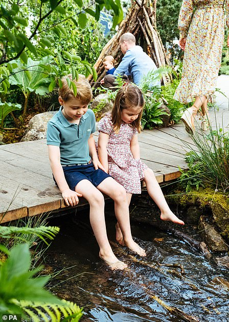 Six year old George dips his toes in the water with sister Charlotte, four, ahead of the RHS Chelsea Flower Show in London, while Prince William plays with youngest son Louis in the background