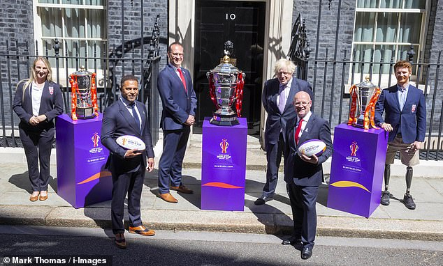 Prime Minister Boris Johnson poses outside Downing Street next to the Rugby League World Cup