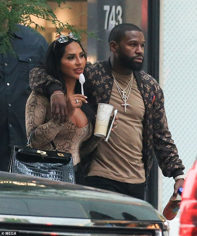 To catch up?  Floyd Mayweather appeared to be in a good mood when he put an arm around his ex Gallienne Nabila on Tuesday while in New York City.