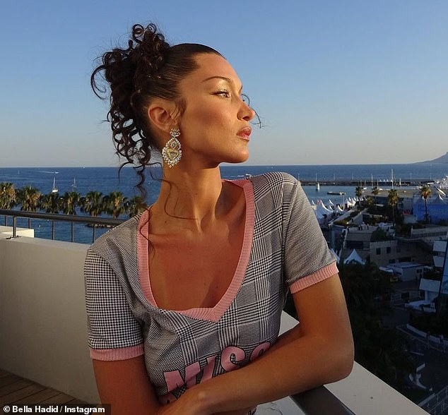 Curly girl!  Dressed in her shimmering raven locks in corkscrew earrings, Bella accessorized herself with a pair of oversized jewelry earrings