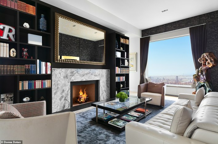 The penthouse is equipped with various accessories, including a wood-burning fireplace