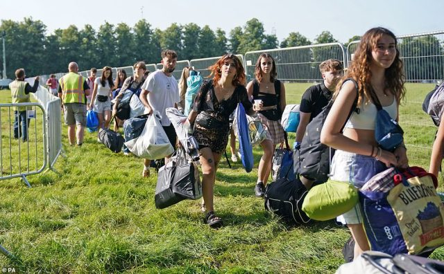 Smiling campers armed with sleeping bags, rucksacks and suitcases queued on the grass in the morning sun before entering the campsite, where headline acts such as Wolf Alice, Bastille and Bombay Bicycle Club will perform