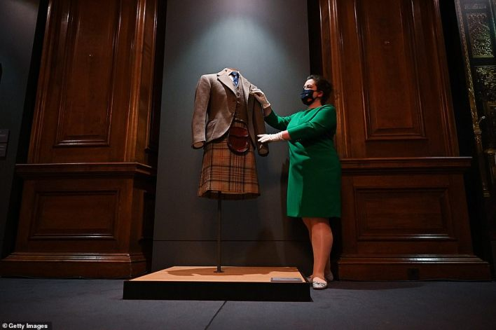 The Duke of Edinburgh 's love of Scotland is being celebrated at a special display which opens its doors at Holyroodhouse tomorrow (pictured, curator Sally Goodsir, views the 1952 Balmoral Tartan Kilt)