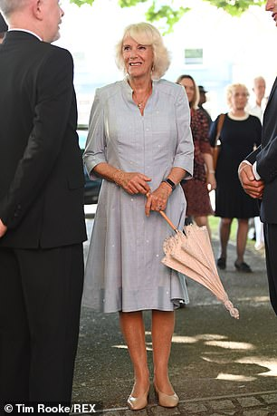 For the royal couple's final outing, Camilla cut a cool figure in a light blue zip-up linen dress decorated with white polka dots and dark sunglasses, while wearing her white-blonde hair carefully coiffed