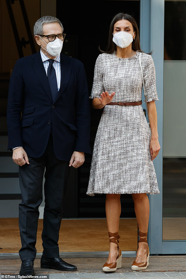 The 48-year-old monarch dressed for the warm weather in the Spanish capital in a gray tweed dress fastened at the waist with a brown leather belt