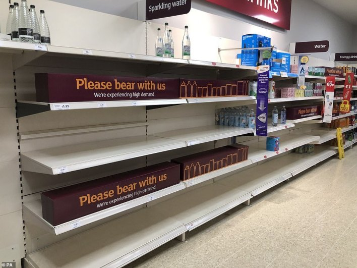 Empty shelves and signs on the soft drinks aisle of a Sainsbury's store in Blackheath, Rowley Regis in the West Midlands
