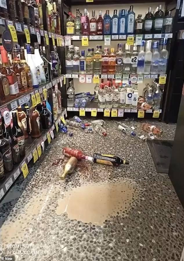 The cheeky animal managed to knock over several bottles of vodka and liquor as it flipped, leaving shards of glass in the aisles