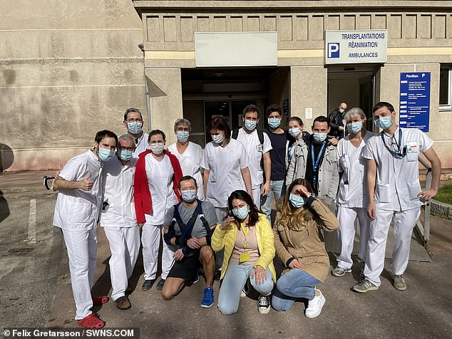 Pictured: Gretarsson (front row, left) with staff from the Edouard Herriot Hospital in Lyon, where he had his transplant surgery
