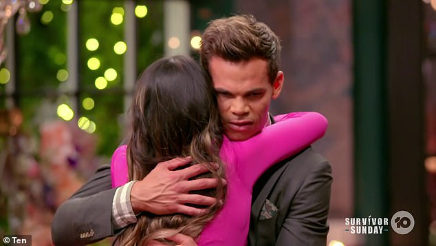 Hug it out: Host Osher Günsberg delivered the crushing news to the hopefuls in his signature somber tone, urging them to say goodbye.  Pictured, Belinda and Bachelor Jimmy Nicholson