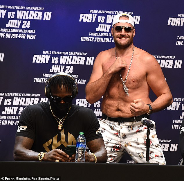 Tyson Fury (right) was forced to delay his trilogy fight against Deontay Wilder (left)