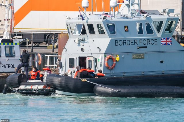 Border Force tow a dingy brings in a group of people thought to be migrants, including children