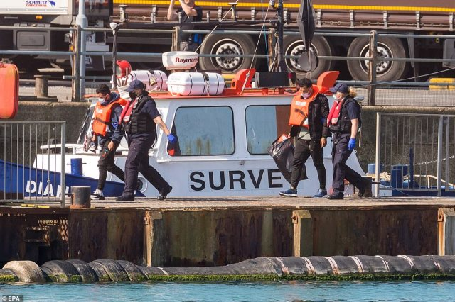 Border Force staff bring onshore a group of people thought to be migrants, including children, found in the English Channel off the coast of Dover in Dover