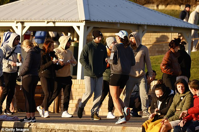 Eastern suburbs locals walking with coffees and chatting with friends (pictured on Thursday), while the city's south-western suburbs face harsher restrictions