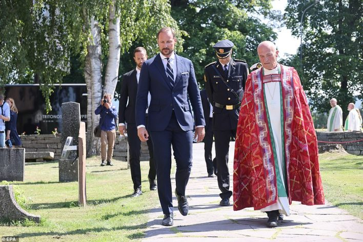 Norway's Crown Prince Haakon (left) and Bishop Jan Otto Myrseth (right) are pictured outside the Hole Church, where they honor the victims today