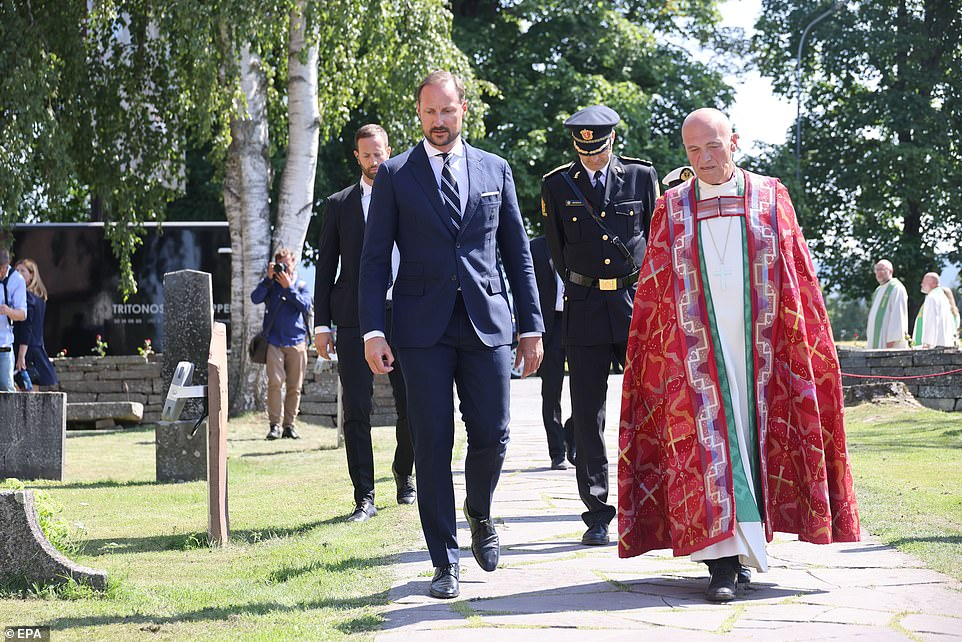 Norway's Crown Prince Haakon (left) and Bishop Jan Otto Myrseth (right) are pictured outside the Hole Church where they honoured the victims today