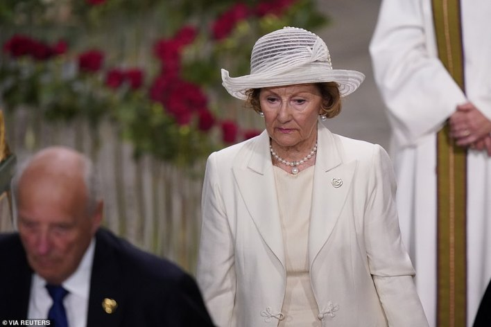Arriving on crutches, 84-year-old King Harald took his place for service next to Queen Sonja in front of Oslo Cathedral as the country observed a minute of silence
