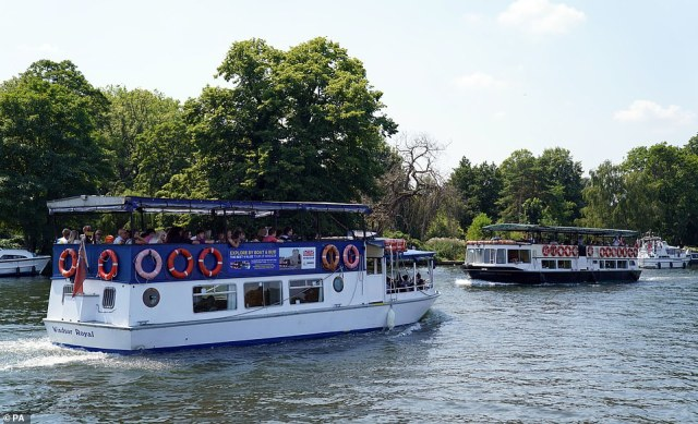 People in boats on the River Thames in Windsor, Berkshire, this afternoon as they enjoy the hot weather