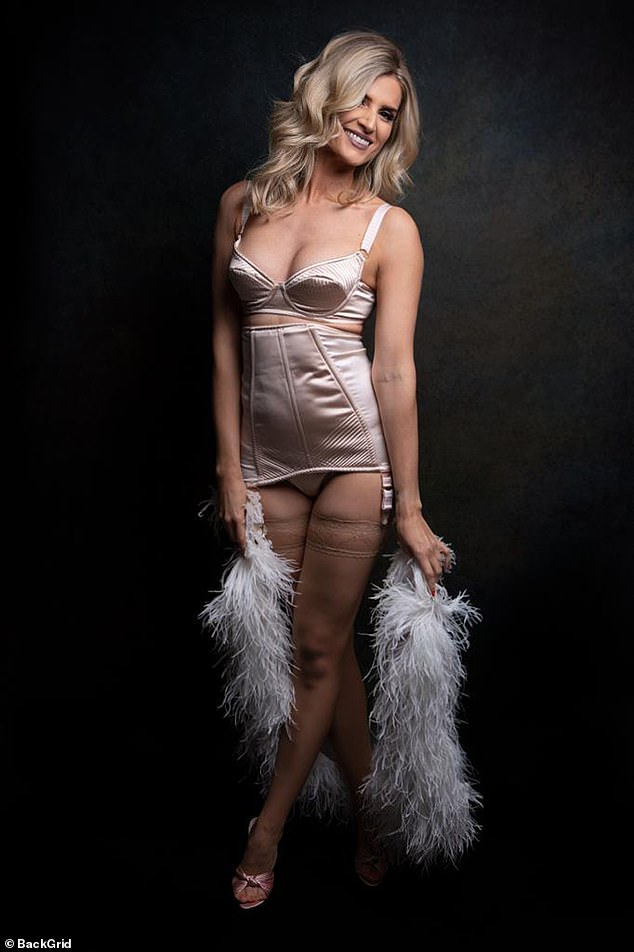 Prop: The actress toted a fun feather boa, which she draped around her legs as she grinned